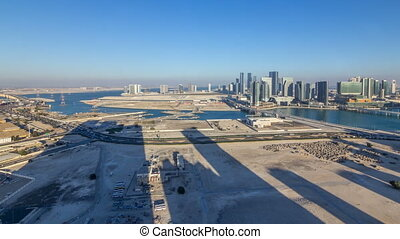 Aerial skyline of Abu Dhabi city centre from above timelapse...