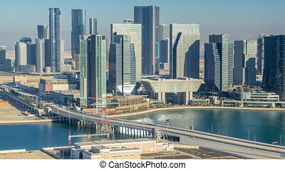 Aerial skyline of Abu Dhabi city centre from above timelapse
