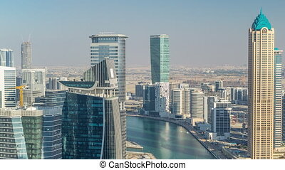 Aerial skyline of Dubai's business bay with skyscrapers ...