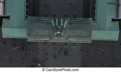 AERIAL: Slow Birds View Overhead shot of Brandenburg Gate roof with Quadriga statue close up and people on the ground 4K