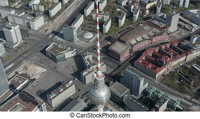 AERIAL: Slow Flight over Spree River in Berlin, Germany with view on Alexanderplatz TV Tower On Beautiful Blue Sky Day