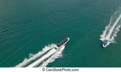 Aerial slow motion shot of touristic boats in a busy Nha Trang harbor. Travel to Vietnam concept