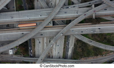 AERIAL: Slow Overhead Flighty Shot of Judge Pregerson Highway showing multiple Roads, Bridges, Viaducts with little car traffic in Los Angeles, California on Beautiful Sunny Day