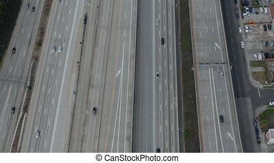 AERIAL: Slow Overhead Lookup over 110 Highway with little car traffic in Los Angeles, California on Cloudy Overcast Day HD