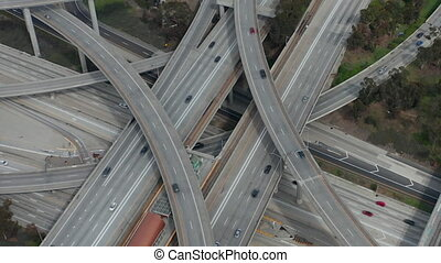 AERIAL: Slowly Circling over Judge Pregerson Huge Highway Connection showing multiple Roads, Bridges, Viaducts with little car traffic in Los Angeles, California on Beautiful Sunny Day HD