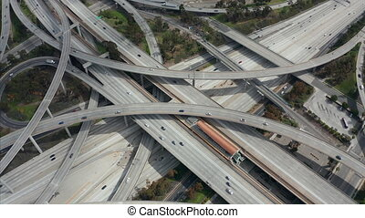 AERIAL: Slowly Circling over Judge Pregerson Huge Highway Connection showing multiple Roads, Bridges, Viaducts with little car traffic in Los Angeles, California on Beautiful Sunny Day 4K