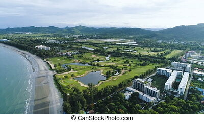 Aerial smooth sliding drone shot with panorama of city Hua...