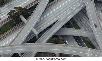AERIAL: Spectacular Fly over Judge Pregerson Highway showing multiple Roads, Bridges, Viaducts with little car traffic in Los Angeles, California on Beautiful Sunny Day