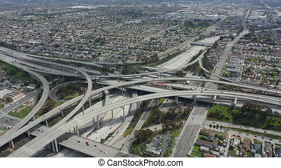 AERIAL: Spectacular Judge Pregerson Highway showing multiple Roads, Bridges, Viaducts with little car traffic in Los Angeles, California on Beautiful Sunny Day