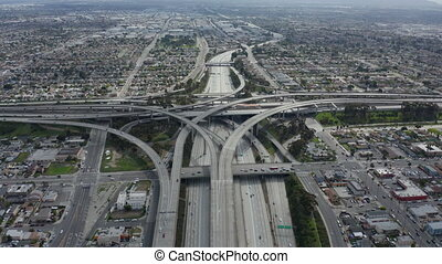 AERIAL: Spectacular Judge Pregerson Highway showing multiple Roads, Bridges, Viaducts with little car traffic in Los Angeles, California on Beautiful Sunny Day 4K