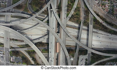 AERIAL: Spectacular Overhead Shot of Judge Pregerson Highway showing multiple Roads, Bridges, Viaducts with little car traffic in Los Angeles, California on Beautiful Sunny Day