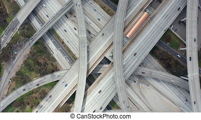 AERIAL: Spectacular Overhead Shot Rising up over Judge Pregerson Highway showing multiple Roads, Bridges, Viaducts with little car traffic in Los Angeles, California on Beautiful Sunny Day