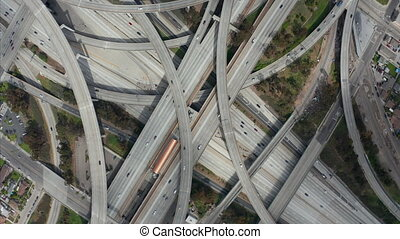 AERIAL: Spectacular Turning Overhead Shot of Judge Pregerson Highway showing multiple Roads, Bridges, Viaducts with little car traffic in Los Angeles, California on Beautiful Sunny Day