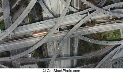 AERIAL: Spectacular Turning Overhead Shot of Judge Pregerson Highway showing multiple Roads, Bridges, Viaducts with little car traffic in Los Angeles, California on Beautiful Sunny Day 4K
