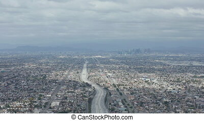 AERIAL: Spectacular View over Endless City Los Angeles, California with Big Highway Connecting to Downtown on Cloudy Overcast Day HD