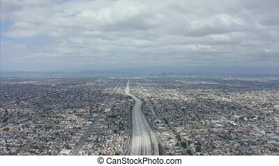 AERIAL: Spectacular View over Endless City Los Angeles, California with Big Highway Connecting to Downtown on Cloudy Overcast Day 4K