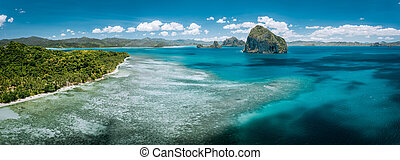 Aerial stunning panorama of turquoise sea water, magnificent limestone cliffs and tropical sea shore n El Nido, Palawan, Philippines