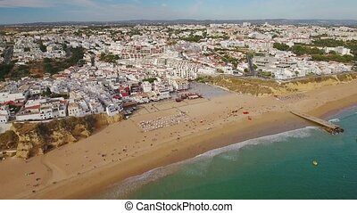 Aerial. Summer beach fishermen view from sky, in Albufeira....