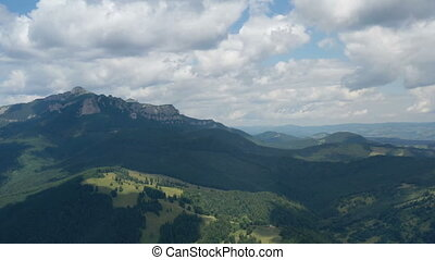 Aerial summer landscape of green forest and rocky mountains ...