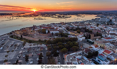 Aerial. Sunset over the old town of Faro, view from the air.