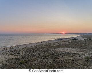 Aerial sunset seascape of Salgados beach in Albufeira, Algarve.