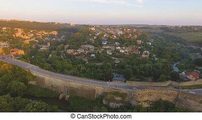 Aerial sunset shot of Kamenets-Podolsky castle in Ukraine
