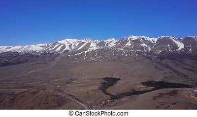 Aerial survey Altai mountains. Beautiful highland landscape....