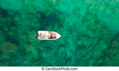 Aerial survey of a couple on a boat sunbathe together on a...