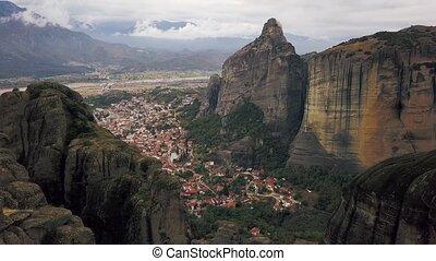 Aerial survey of Kalambaka town and Meteora - rock formation...