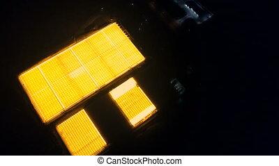Aerial survey of luminous greenhouses - Flight at night over...