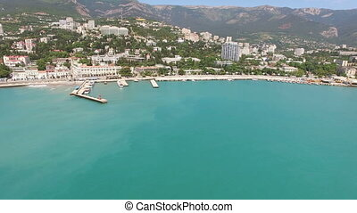 Aerial survey of the resort of the Crimean city of Yalta in the summer