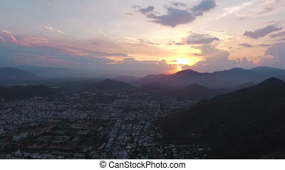 Aerial Survey Sunset over the city in Asia