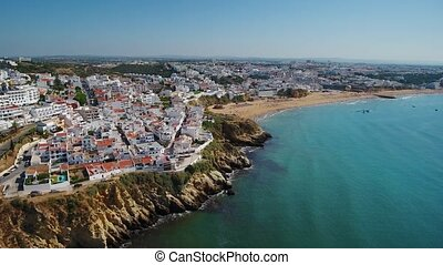 Aerial. The magnificent beach of fishermen, in the city of Albufeira, view from the sky. Portugal
