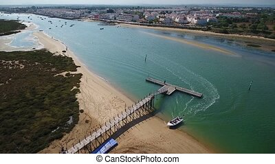 Aerial. The sand dunes of Ria Formosa and the pier. Cabanas...