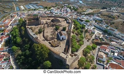 Aerial. The village of Castro Marim and the castle, filmed...