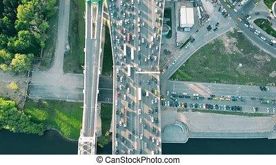 Aerial tilt shot of heavy traffic jam in the business...