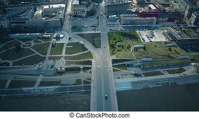 Aerial tilt shot of Vistula river embankment and distant...