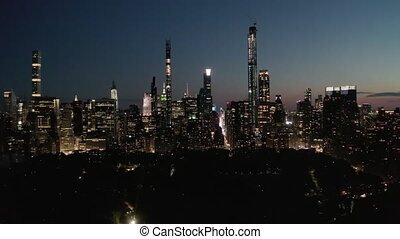 AERIAL: Time Lapse Hyper Lapse over New York City Central Park at Night with Skyline View