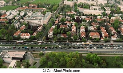 Aerial time lapse of a traffic jam in residential area of a...