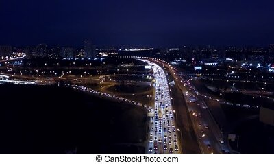 Aerial time-lapse of congested traffic on city highways in the evening rush hour