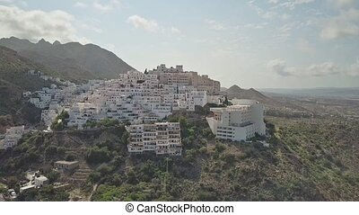 Aerial time lapse of mountainous Spanish town in Andalusia -...