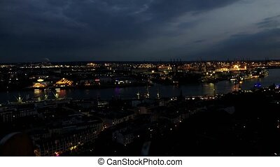 Aerial timelapse of Hamburg in the evening with port and boats