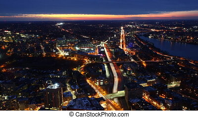 Aerial timelapse of the Boston city center at night with zoom