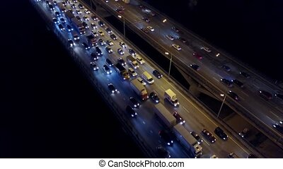 Aerial timelapse of traffic jam on city highway in the evening rush hour