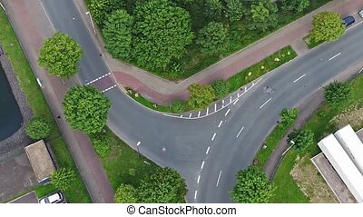 AERIAL: Timelapse of traffic using a junction