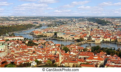 Aerial timelapse view of the Old Town architecture with red roofs in Prague , Czech Republic. St. Vitus Cathedral in Prague. Time lapse.