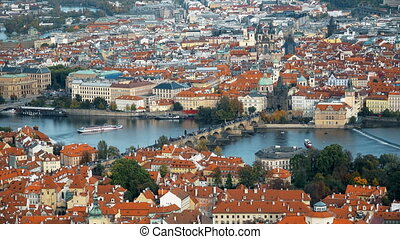 Aerial timelapse view of the Old Town architecture with red roofs in Prague , Czech Republic. Vltava river. Prague Charles bridge old town panorama. Time lapse.