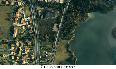 Aerial top down shot of industrial area, river and highway...