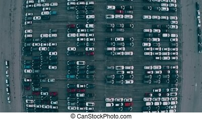 Aerial top down view of a big automotive factory new cars...