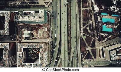 Aerial top down view of a big city road interchange
